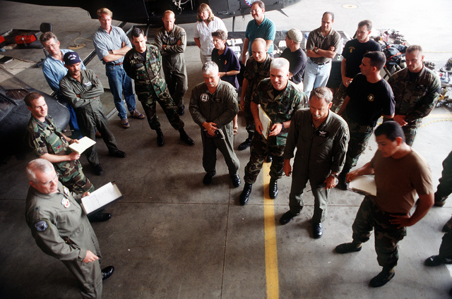 BGEN Donald A. Streater (lower left corner), commander of the A-10 recovery effort, conducts an outbrief of the day's efforts, and then briefs his crew on the following day's efforts