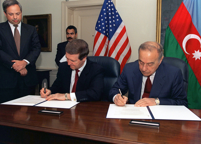 Secretary of Defense William S. Cohen (left) and President Heydar Aliyev (right) of the Azerbaijani Republic sign a joint statement emphasizing the development of strong US-Azerbaijani defense cooperation. As a further step toward deepening the bilateral relationship, both sides expressed their intention to maintain regular consultations and exchanges between defense ministries on issues of security and military cooperation. The signing took place on July 31, 1997 at the Pentagon