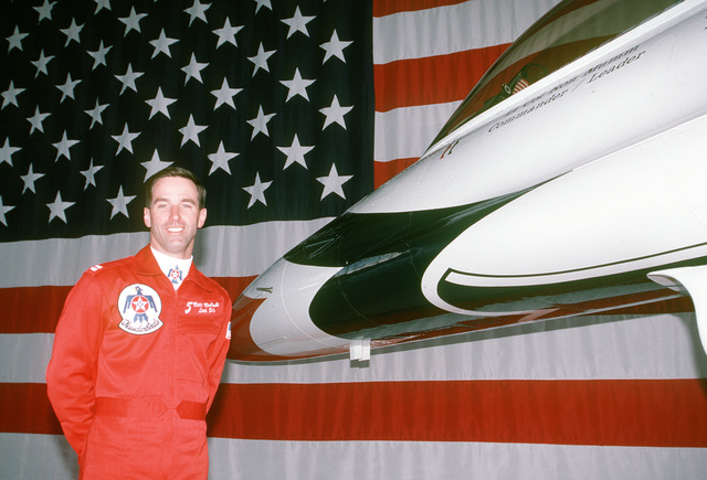 CAPT. Matt Modleski, the U.S. Air Force Thunderbirds lead solo pilot, stands in front of an F-16 Fighting Falcon inside the aerial demonstration squadron's hangar at Nellis AFB. Modleski initially enlisted in the Air Force as a jet engine mechanic, retrained into air traffic control and got his commission after earning a bachelor's degree at night. Exact Date Shot Unknown . Published in AIRMAN Magazine August 1997