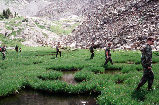 Members of the A-10 recovery team search along East Brush Creek for any remnants of the four 500 pound Mark 82 bombs that were carried by the A-10 that crashed on Gold Dust Peak