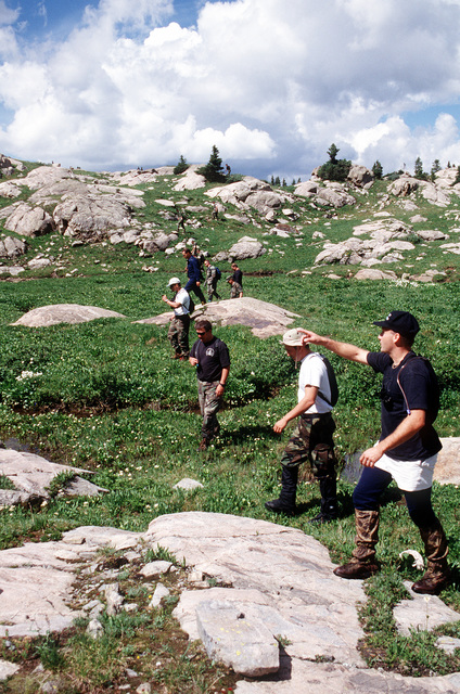 Members of the A-10 recovery team search for any remnants of the four 500 pound Mark 82 bombs that were carried by the A-10 that crashed on Gold Dust Peak