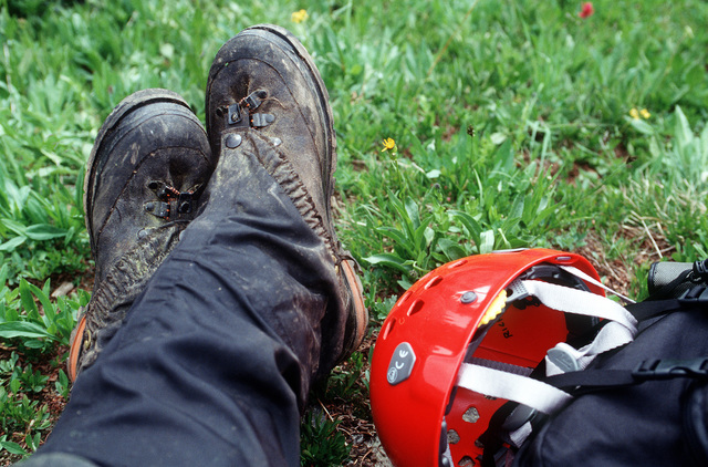 The feet and helmet of one of the A-10 recovery team members is seen resting after a long hard day of searching for remnants of the A-10 and the four 500 pound Mark 82 bombs