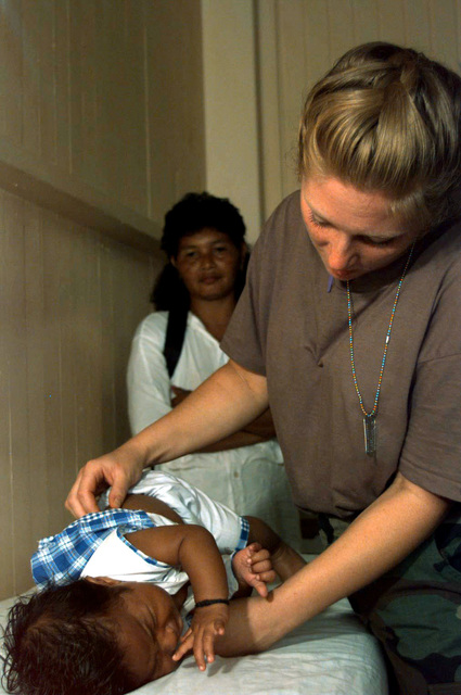 2nd LT Camille Troy, a registered nurse with the 126th Medical Squadron, Illinois Air National Guard, O'Hare International Airport, Chicago, IL, treats a Guyanese baby for a fever during this first combined humanitarian and civic assistance exercise conducted between the United States and Guyana. Military personnel from the Air Force, Air Force Reserve and National Guard, Army, Army National Guard and Marine Corps participated in the exercise which included engineering and medical readiness training