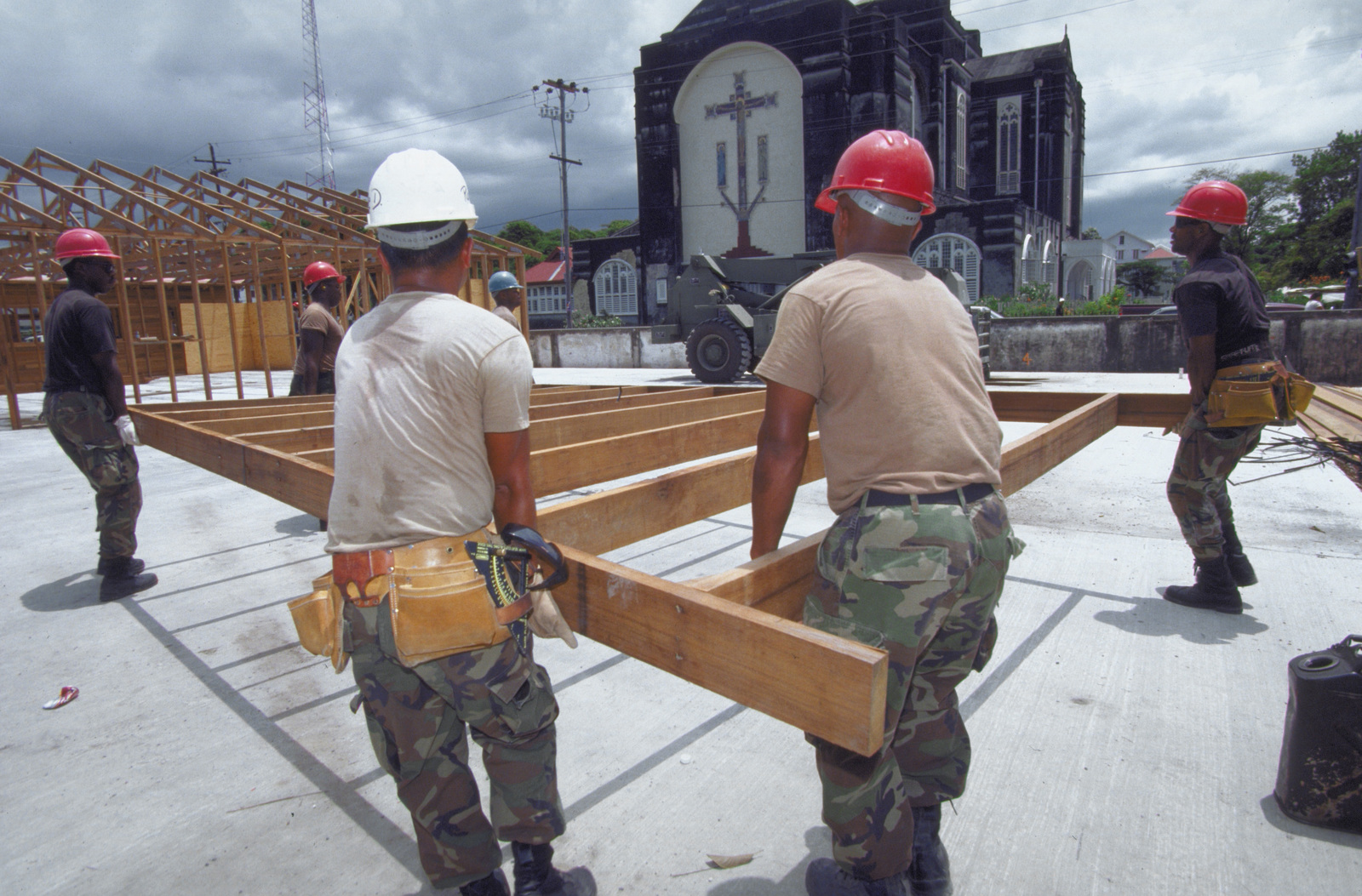 Members from the 820th Red Horse Squadron, Nellis Air Force Base, Nevada move framing into place as they work on a new school building. The school is being rebuilt to replace the old St. Mary's High School in downtown Georgetown as part of the first combined humanitarian and civic assistance exercise conducted between the United States and Guyana. Military personnel from Air Force, Air Force Reserve & National Guard, Army, Army National Guard and Marine CorpS participated in the exercise which included engineering and medical readiness training
