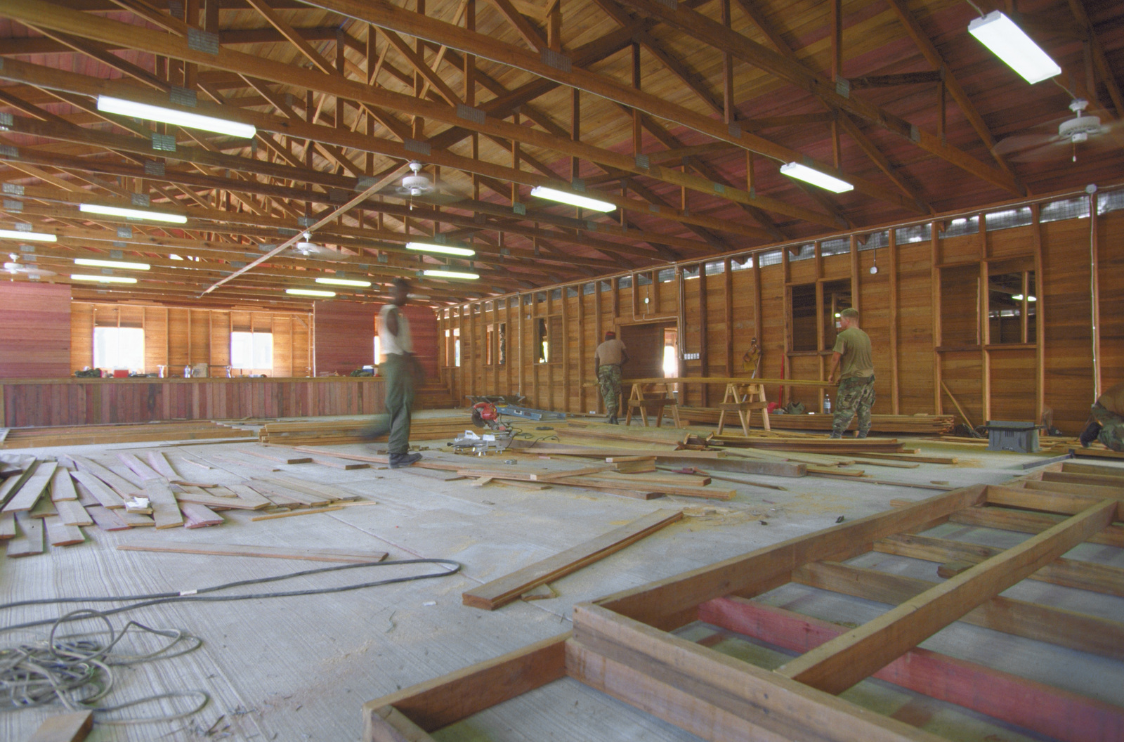 Members from the 820th Red Horse Squadron, Nellis Air Force Base, Nevada, work on the interior construction of a new school building. The school is being rebuilt to replace the old St. Mary's High School in downtown Georgetown as part of the this first combined humanitarian and civic assistance exercise conducted between the United States and Guyana. Military personnel from Air Force, Air Force Reserve & National Guard, Army, Army National Guard and Marine Corps participated in the exercise which included engineering and medical readiness training