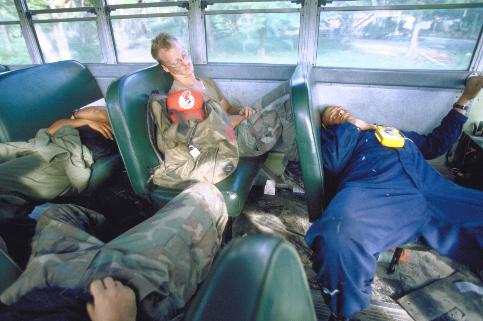 Member of the 820th Red Horse Squadron, Nellis Air Force Base, Nevada and Marines assigned to the 274th Marine Support Squadron, Cherry Point, N.C., after a hard day's work, sleep on the bus trip back to Camp Stephenson. The workers are returning from renovating the Ascension Community High School in Georgetown as part of the this first combined humanitarian and civic assistance exercise conducted between the United States and Guyana. Military personnel from Air Force, Air Force Reserve & National Guard, Army, Army National Guard and Marine Corps participated in the exercise which included engineering and medical readiness training