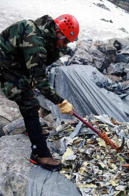 1LT Eric J. Soto, an Accident Investigation Board member, looks through an A-10 debris pile at the lower debris field