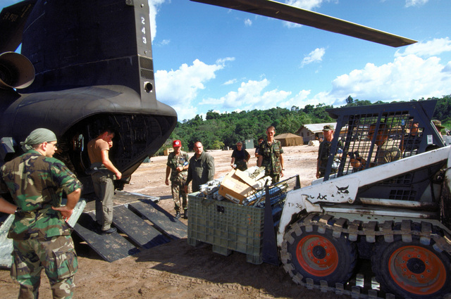 Air National Guard medical personnel from the 126th Medical Squadron, O'Hare Field, Chicago, Ill., off load their supplies using a forklift after flying into Malali, from a CH-47 helicopter. The medical personnel will provide medical aid to the local Guyanese as part of the this first combined humanitarian and civic assistance exercise conducted between the United States and Guyana. Military personnel from Air Force, Air Force Reserve & National Guard, Army, Army National Guard and Marine Corps participated in the exercise which included engineering and medical readiness training