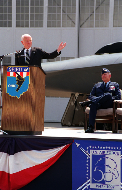 """During dedication of the B-2 """"Spirit of Ohio"""" stealth bomber, Senator John Glenn, democrat-Ohio speaks and motions from the podium in front of the aircraft. Listening on the stage is LGEN Brett Dula, Vice Commander Air Combat Command"""