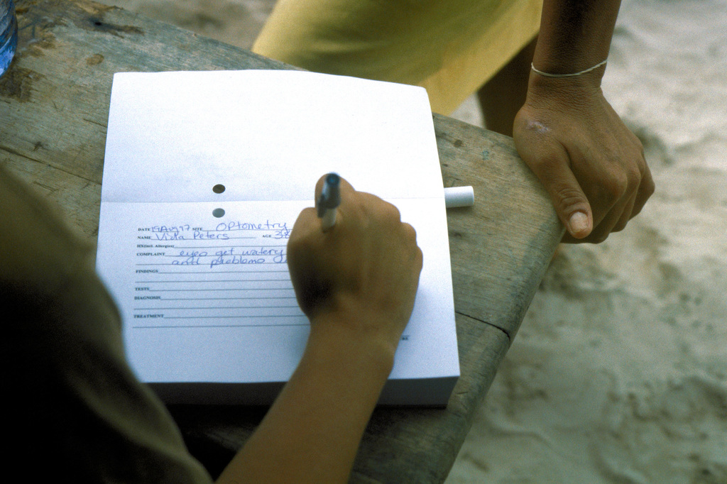 A medical technician from the 126th Medical Squadron, O'Hare Field, Chicago, Ill. fills out a patient form for a Guyanese lady seeking medical assistance at the medical aid tent. The 126th was one of the units supporting New Horizon '97, first combined humanitarian and civic assistance exercise conducted between the United States and Guyana. Military personnel from the Air Force, Air Force Reserve & National Guard, Army, Army National Guard and Marine Corps participated in the exercise which included engineering and medical readiness training