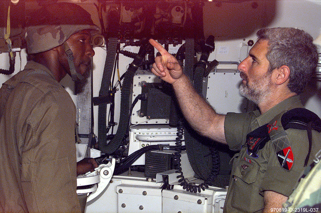 BGEN Dan Harel, Commander Israeli Defense Force Artillery, gets briefed on the M109A6 Paladin Self-propelled Howitzer prior to his live fire exercise