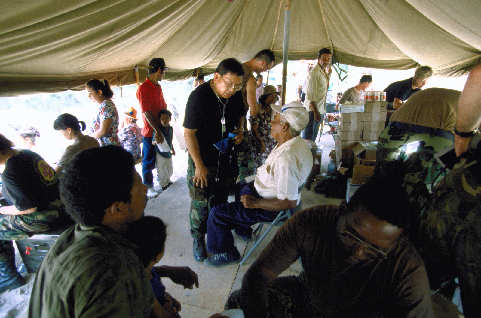 Dr. (LT. COL.), Pedro Peralta, (center) assigned to the 126th Medical Squadron, O'Hare Field, Chicago, Ill. attends to patients from the local community of Malali. 126th personnel provided three days of medical care the local population in support of the first combined humanitarian and civic assistance exercise conducted between the United States and Guyana. Military personnel from Air Force, Air Force Reserve & National Guard, Army, Army National Guard and Marine Corps participated in the exercise which included engineering and medical readiness training