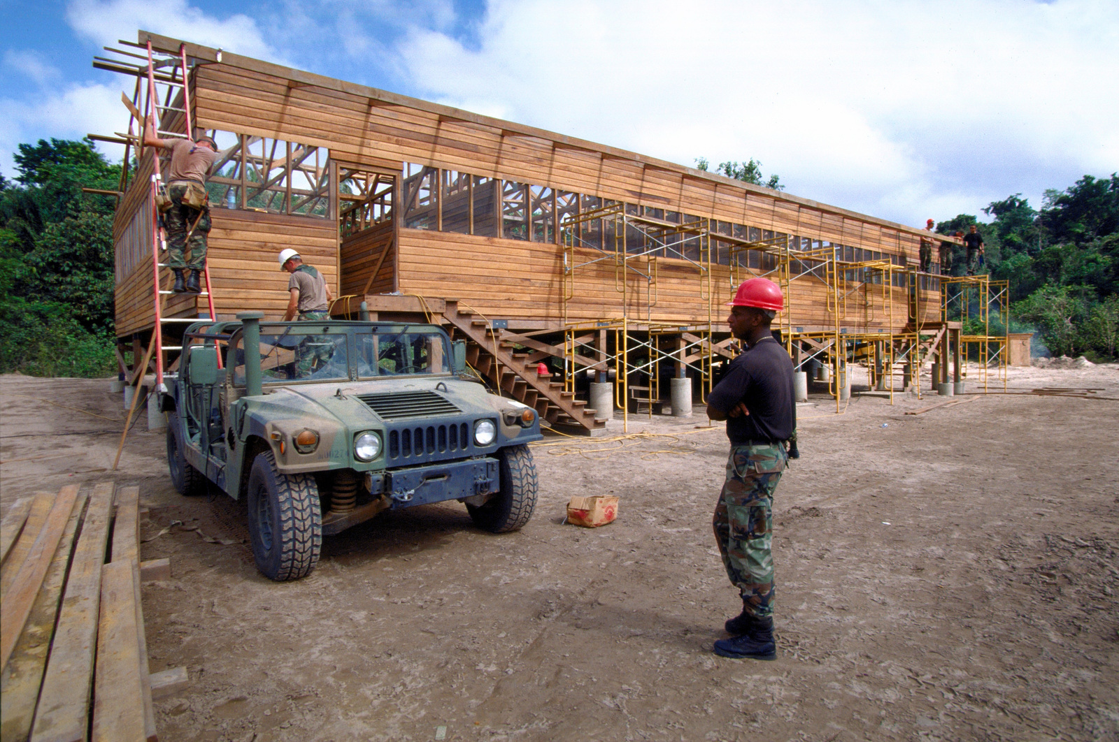 Members of the 820th Red Horse Squadron, Nellis Air Force Base, Nevada and engineers from the 4th Battalion, Guyana Defense Force work together to build a new school for the Malali region of Guyana. The 820th is participating to support the first combined humanitarian and civic assistance exercise conducted between the United States and Guyana. Military personnel from Air Force, Air Force Reserve & National Guard, Army, Army National Guard and Marine Corps participated in the exercise which included engineering and medical readiness training