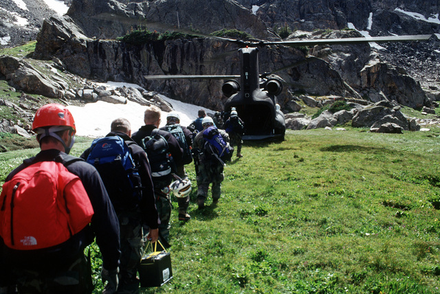 A-10 recovery team members approach the rear of the CH-47 for their ride home after searching all day for remnants of the A-10 that crashed near Gold Dust Peak and the four 500 pound Mark 82 bombs. The helicopter is assigned to Detachment 1, Company G, 140th Aviation, Nevada Army National Guard