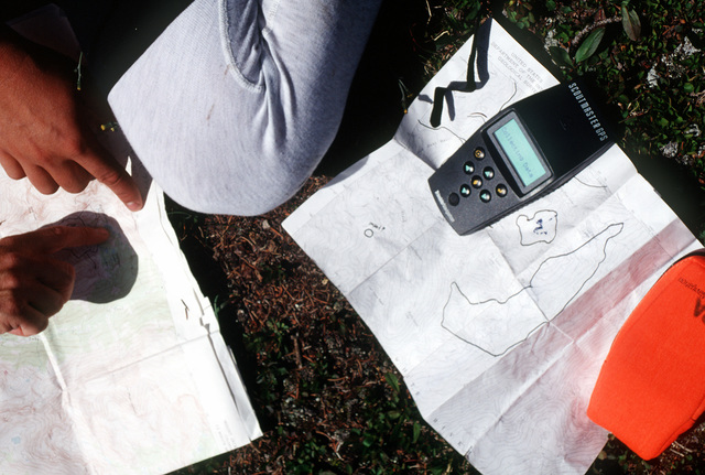 Members of the A-10 recovery team confirm the areas searched along East Brush Creek in their attempts to locate any remnants of the A-10 that crashed on Gold Dust Creek and the four 500 pound Mark 82 bombs