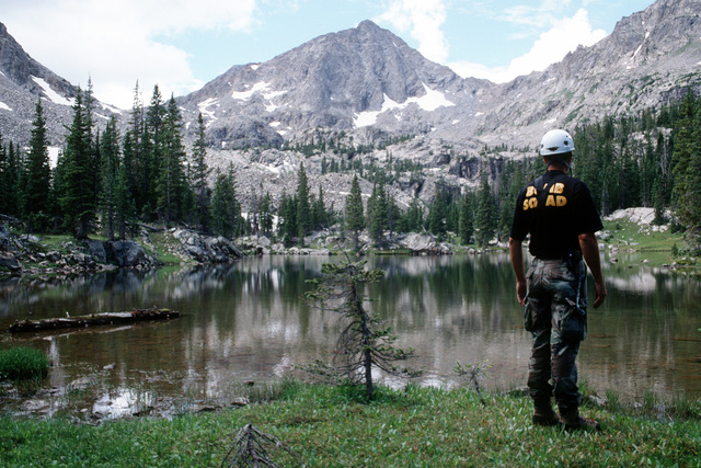 MSGT Eric Wass, Explosive Ordnance Disposal member, takes a well deserved break during the ground search of the lakes around Gold Dust Peak for remnants of the A-10 and the four 500 pound Mark 82 bombs