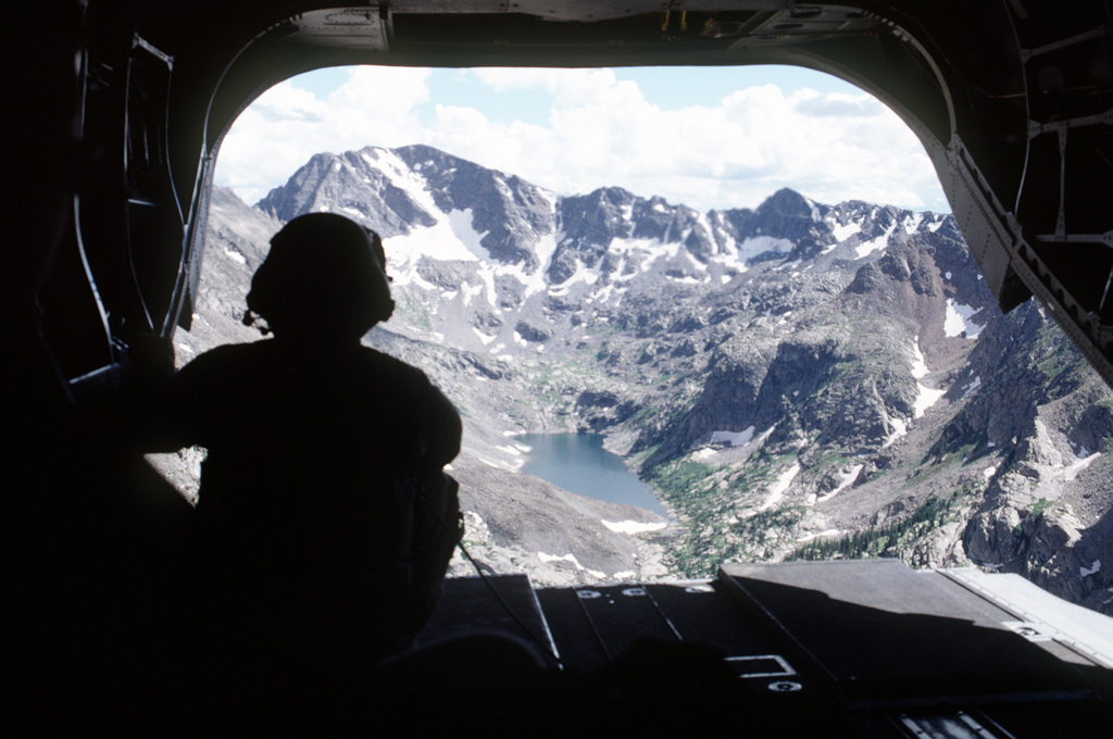 SGT Don Gable, a CH-47 flight engineer assigned to Detachment 1, Company G, 140th Aviation, Nevada Army National Guard, looks back at Gold Dust Peak during the return flight to Eagle Base