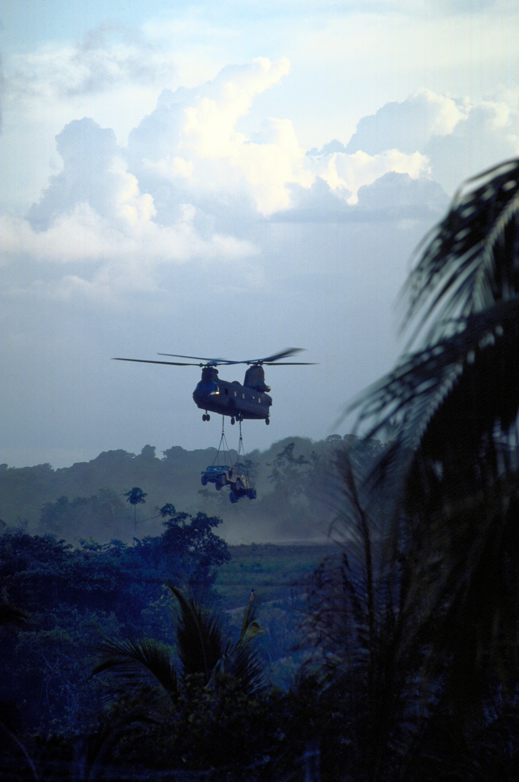 A CH-47 Chinook helicopter leaves the Kumaka airfield carrying a sling loaded High-Mobility Multipurpose Wheeled Vehicle (HMMWV). The CH-47 from the Army National Guard's Det 1, 106th Aviation Squadron, Davenport, Iowa, will redeploy the equipment from Kumaka back to Camp Stephenson, Timehri Guyana. The equipment was used to assist in renovating the existing regional hospital as part of this first combined humanitarian and civic assistance exercise conducted between the United States and Guyana. Military personnel from Air Force, Air Force Reserve & National Guard, Army, Army National Guard and Marine Corps participated in the exercise which included engineering and medical readiness ...