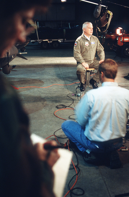 BGEN Don Streater, commander of the A-10 recovery team conducts a live interview with ABC's Good Morning America regarding the status of the recovery efforts near Gold Dust Peak. CPT Robyn Chumley (far left), Public Affairs officer, takes notes on the questions asked and answers given so that an outbrief can be conducted with the general after the telecast
