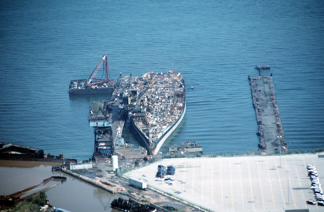 Aerial bow view of the aircraft carrier CORAL SEA (CV 43) in the late stages of being scrapped out at the Lambert Point facility of the new Patapsco Marine Salvage Company