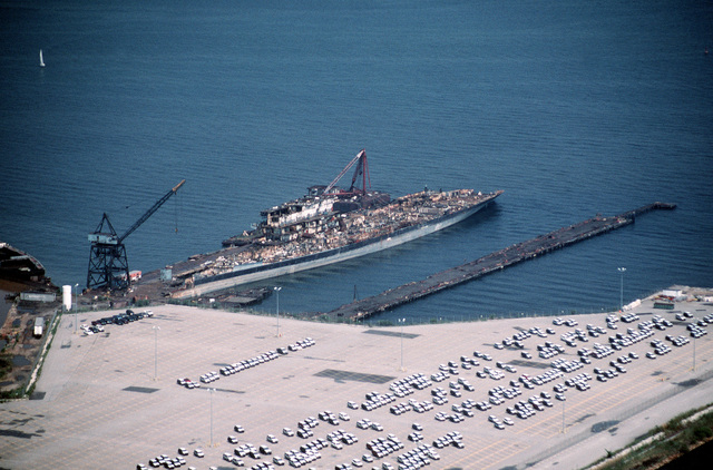 Aerial port bow view of the aircraft carrier CORAL SEA (CV 43) in the late stages of being scrapped out at the Lambert Point facility of the new Patapsco Marine Salvage Company