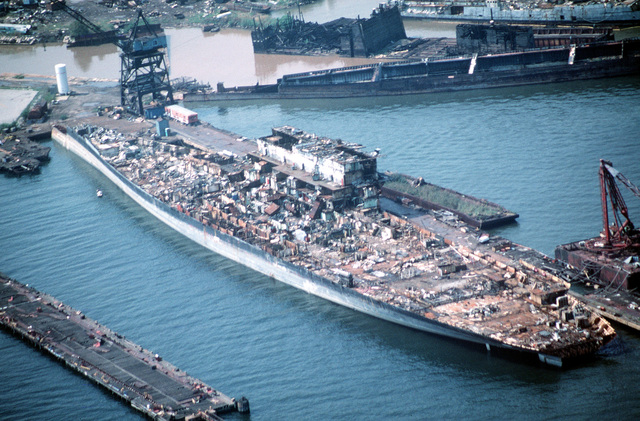 Aerial port quarter view of the aircraft carrier CORAL SEA (CV 43) in the late stages of being scrapped out by the new Patapsco Marine Salvage Company. The Fairfield Terminal is located at Lambert Point on the outer harbor