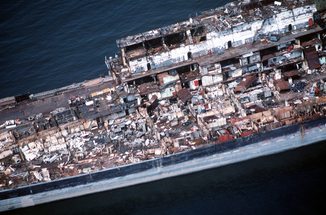 Aerial view from the port side of the fore section of the aircraft carrier CORAL SEA (CV 43) being scrapped out at the Lambert Point facility of the new Patapsco Marine Salvage Company