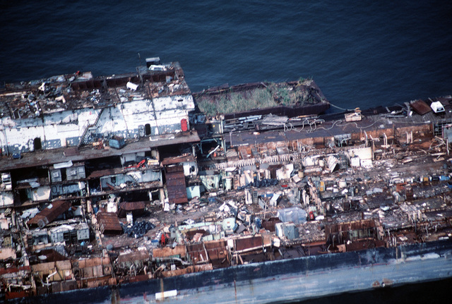 Close-in aerial view, from the port side, of a section of the aircraft carrier CORAL SEA (CV 43) aft of the former island section during the late stages of the ship being scrapped out at the new Patapsco Marine Salvage Company