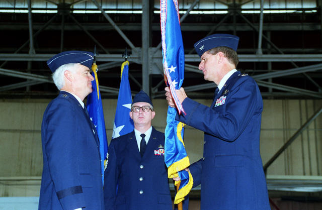 COL Gregory L. Trebon (right) receives the 24th Wing flag from LGEN Frank D. Campbell (left), 12th Air Force commander, during the change of command ceremony