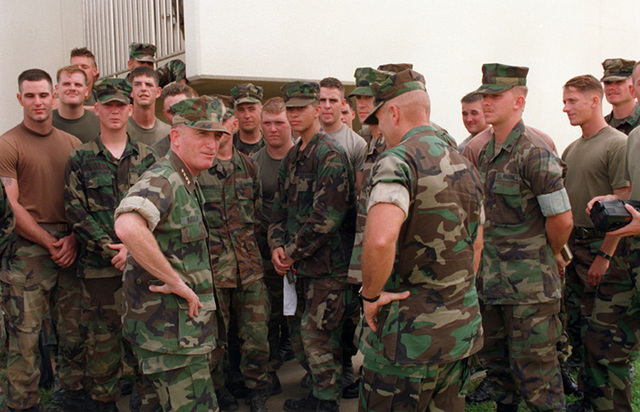 General Charles C. Krulak, Commandant of the Marine Corps, visits with Marines stationed on Camp Hansen during his visit