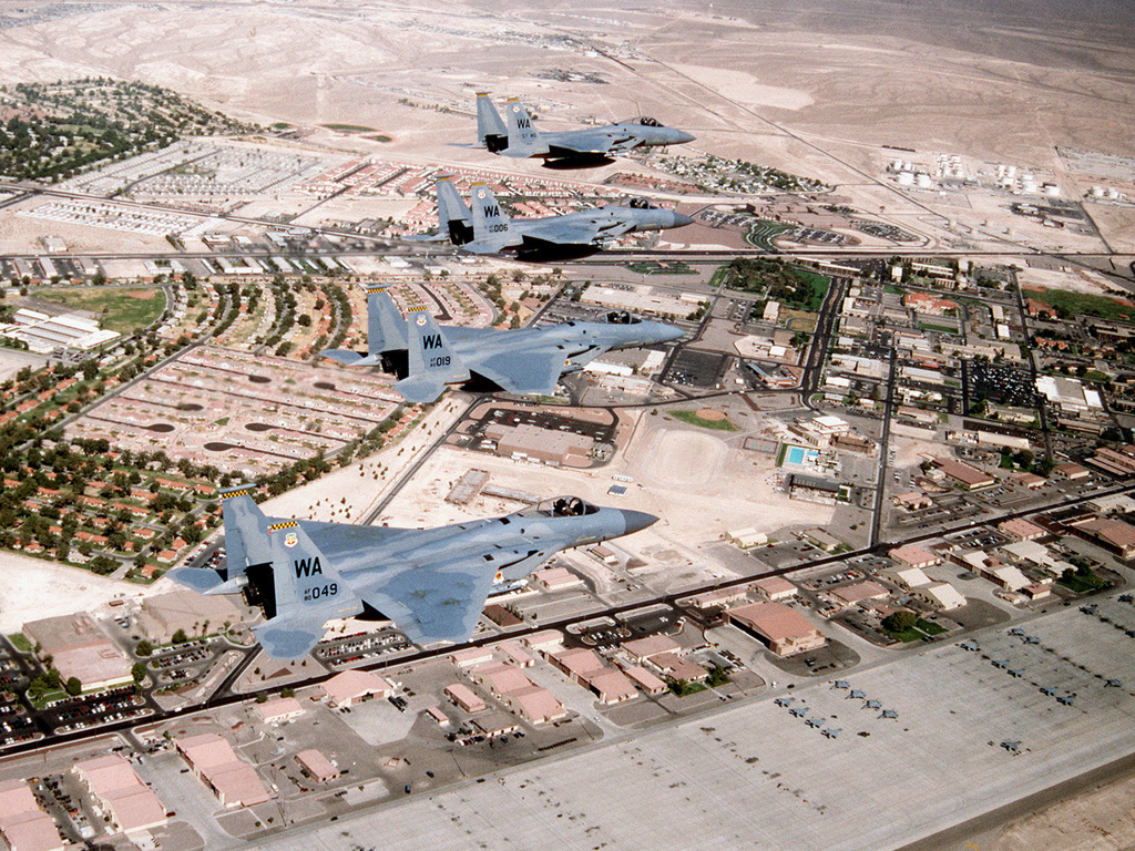 F-15C and F-15E model fighters from the U.S. Air Force Fighter Weapons School, Nellis AFB, Nevada fly in formation over the skies above the ranges north of Nellis after flying a training mission during the extensive course