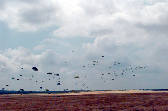 Soldiers from the U.S. Army's 82nd Airborne Division complete their jump from a U.S. Air Force C-17 aircraft at Sicily drop zone at Fort Bragg. Among the participants in this jump are soldiers from Kazakstan, Kyrgyzstan, and Uzbekistan. This practice jump is in preparation for the joint exercise between the 82nd Airborne Division and troops from central Asia and other countries, including Russia and Turkey. It will combine airborne operations, weapons training, and cultural exchanges in order to strengthen the partnership between all the participants while improving conditions for a successful partnership for peace exercise