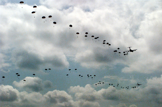 The sky is filled with parachutes after soldiers from the U.S. Army's 82nd Airborne Division complete their jump from a U.S. Air Force C-17 aircraft at Sicily drop zone at Fort Bragg. Among the participants in this jump are soldiers from Kazakstan, Kyrgyzstan, and Uzbekistan. This practice jump is in preparation for the joint exercise between the 82nd Airborne Division and troops from central Asia and other countries, including Russia and Turkey. It will combine airborne operations, weapons training, and cultural exchanges in order to strengthen the partnership between all the participants while improving conditions for a successful partnership for peace exercise