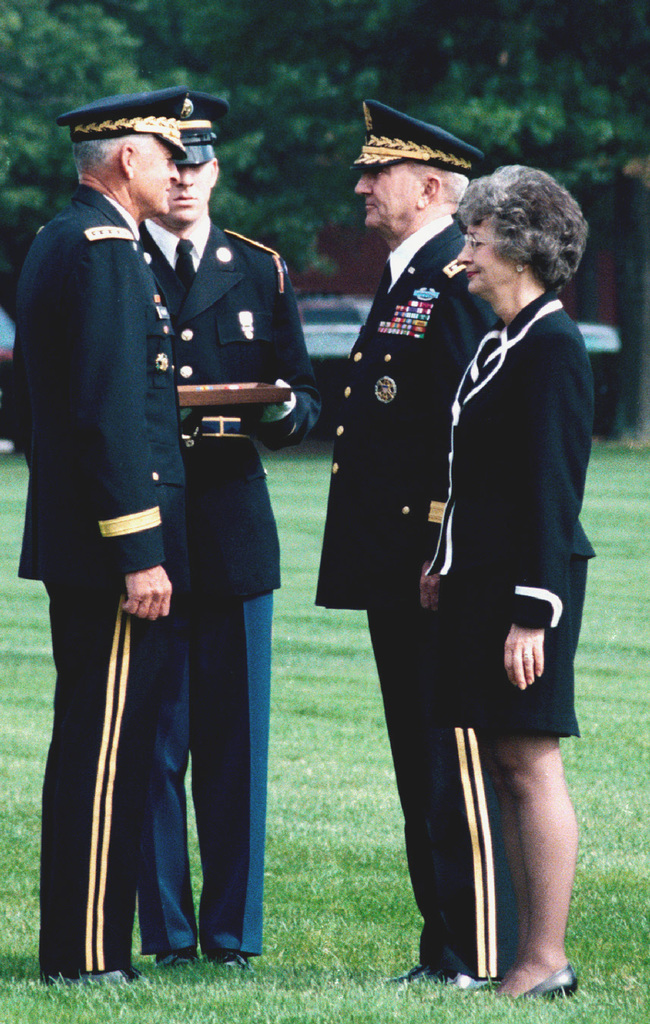 US Army CHIEF of STAFF General (GEN) Dennis J. Reimer (left) prepares to present US Army Vice-CHIEF of STAFF GEN Ronald H. Griffith the Distinguished Service Medal during GEN Griffiths Retirement Ceremony, being held at Summerall Field, Fort Myer, Virginia (VA). The Generals Wife Mrs. Hurdis Griffit, stands at her husbands side. GEN Griffith, a two-year Vietnam War veteran, commanded the 1ST Armored Division during Operation DESERT STORM