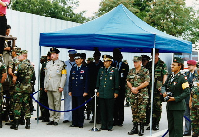 The official party of GEN. John H. Tilelli, Commander in CHIEF, United Nations Command/US Forces Korea/Combined Forces Command Korea, and COL Thomas R. Riley, United Nations Command Military Armistice Commission (UNCMAC) Secretariat are waiting to see the repatriation