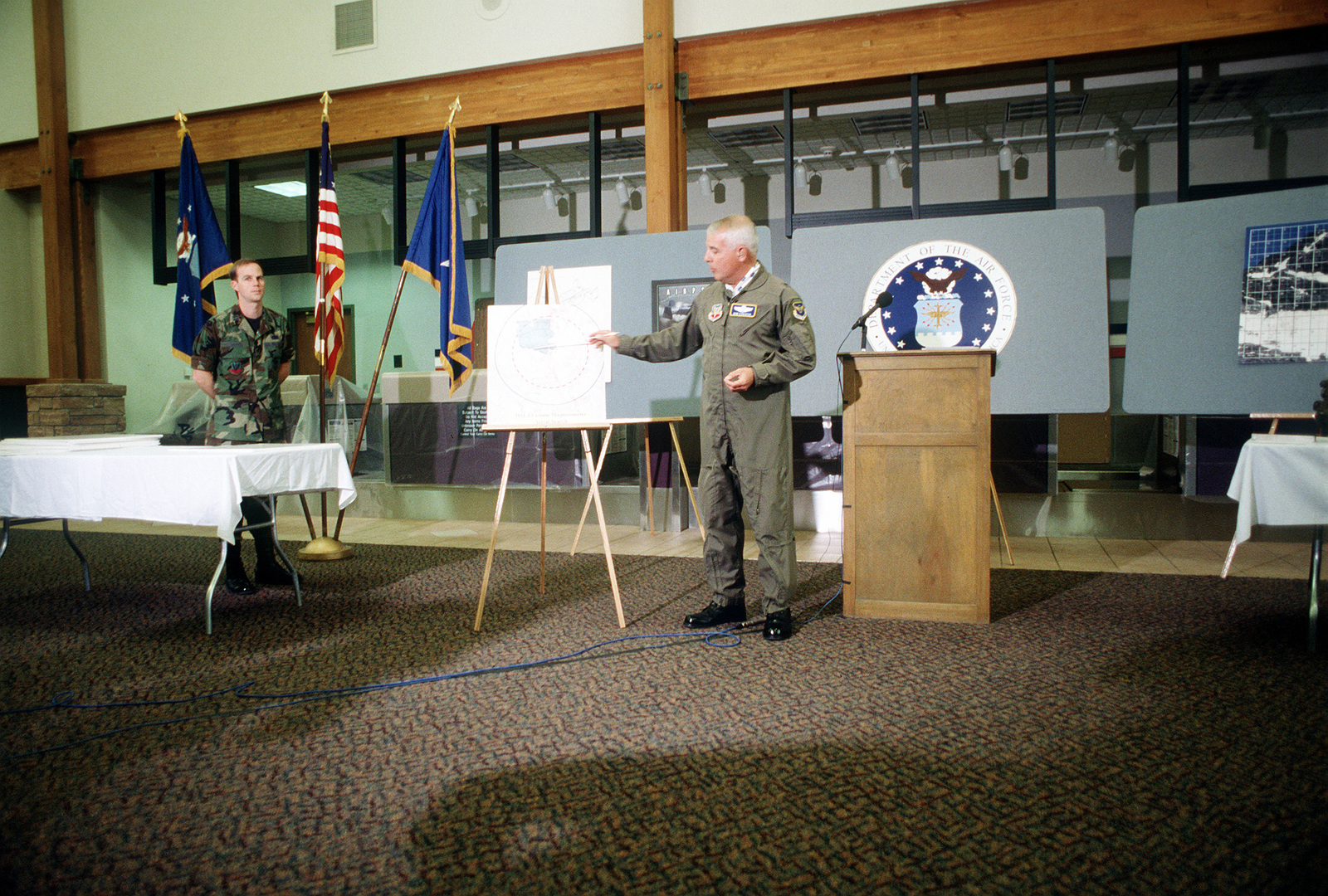 BGEN Donald A. Streater, A-10 recovery effort commander, conducts a final briefing to assure the public that the missing Mark 82 bombs are not in the vicinity of Gold Dust Peak crash site and to state that the Air Force has ceased the search operation