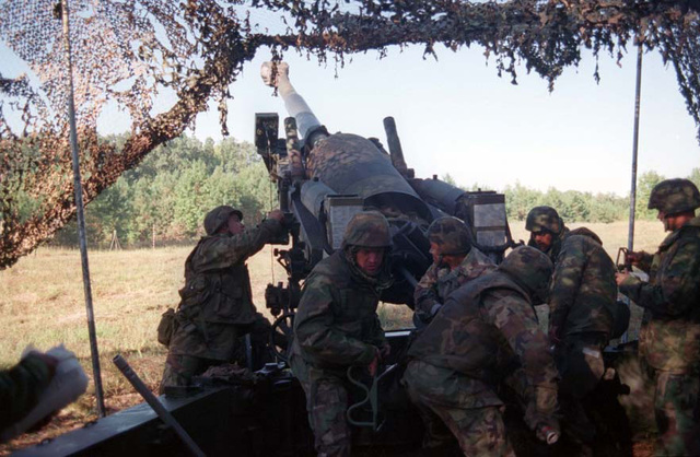 Marines from Kilo Battery, 3rd Battalion, 10th Marine Regiment, fire their M198 Howitzer during a fire support coordination exercise. These Marines are attached to Battalion Landing Team 3/2. (Duplicate image, see also DMSD0207682 or search 970916M1903W001)
