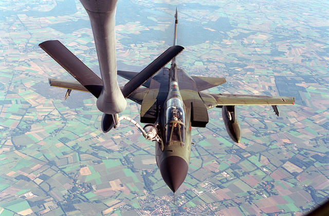 A German GR1 Tornado high speed attack aircraft receives fuel from a U.S. Air Force KC-135R tanker. The tanker is using a modified boom with a drogue receptacle to service the aircraft. The tanker and crew is assigned to the 912th ARS from Grand Forks AFB, North Dakota, on temporary assignment to the European Tanker Task Force at RAF Mildenhall, England