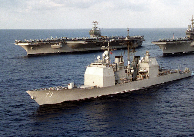 The Ticonderoga-class guided missile cruiser PORT ROYAL (CG 73) steams along side the aircraft carriers USS NIMITZ (CVN 68) and USS INDEPENDENCE (CV 62) during the final stages of exercise Valiant Blitz '97, off the coast of Yokosuka, Japan. Valiant Blitz provided an opportunity for the carriers to demonstrate power projection through bilateral flight operations