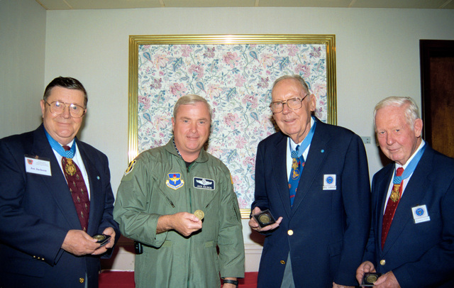 Medal of Honor recipients, LTC Joe M. Jackson, Ret., 1LT William R. Lawley, Jr., Ret. and MAJ Bernard F. Fisher, Ret., proudly hold their 314th Airlift Wing Collectors Coins, awarded them during the Medal of Honor Society Luncheon