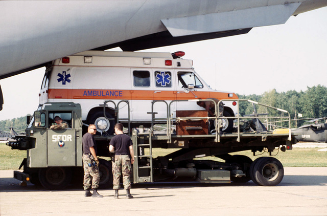 Members of the Tuzla Air Base Aerial Port Squadron stand