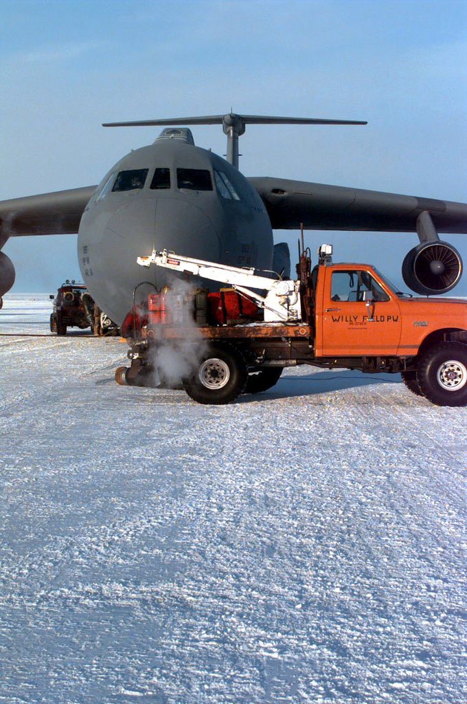 A truck to provide hot air, to warm the C-141 Starlifter assigned to the 8th Airlift Squadron (AS), 62nd Airlift Wing, McChord Air Force Base, Washington sits in front of the aircraft's nose. The aircraft is being offloaded at the rear. The 8th AS is deployed to support the joint, U.S. Armed Forces and New Zealand Defense Force, military operation which provides logistic support to the U.S. National Science Foundation's Program on Antarctica