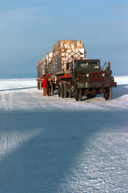 After offloading, from an aircraft, a flatbed truck filled with pallets of critical cargo for the personnel at the U.S. base, sits on the ice runway. The base is home to the U.S. National Science Foundation's Antarctic Program and is supported, with critical airlift of supplies, by a joint military operation, of the United States Armed Forces and the New Zealand Defense Force. SCREEN RESOLUTION ONLY