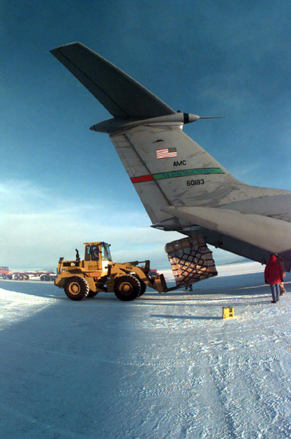 Cargo is offloaded, using a front end loader, from the C-141 Starlifter assigned to the 8th Airlift Squadron (AS), 62nd Airlift Wing, McChord Air Force Base, Washington. The plane sits on the six foot thick ice runway at the base after a flight from Christchurch, New Zealand. The 8th AS is deployed to support the joint, U.S. Armed Forces and New Zealand Defense Force, military operation which provides logistic support to the U.S. National Science Foundation's Program on Antarctica. SCREEN RESOLUTION ONLY