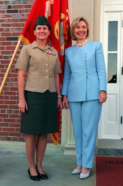 First Lady Hillary Rodham Clinton poses with Brig. GEN. F. E. Wilson, Commanding General