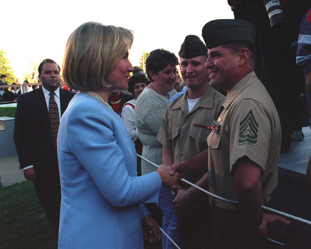 First Lady Hillary Rodham Clinton shakes hands with GUNNERY SGT. Baca