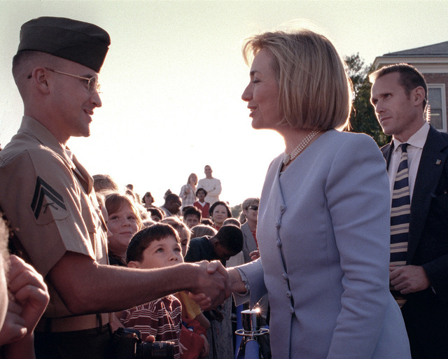 First Lady Hillary Rodham Clinton shakes hands with photographer, CPL. Scott P. Nelson