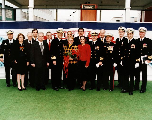 (Left to right) Captain Rubel; Mrs. Ruth Metcalf; Colonel Metcalf; the Honorable Tom Allen, Rep-Maine; Mr. Allan Cameron CEO-B/W; Mr. John Kuesters, Deputy PEO/AEGIS Program; Rear Admiral (Upper half) Michael T. Coyle, USN; the Honorable John Baldacci of Maine; Lieutenant Colonel Robin Higgins, USMC (Ret.) - ships sponsor; Senator Charles Robb of Virginia; Lieutenant Colonel Joanne Schilling, USMC (Ret.) matron of honor; Captain Ralph Staples, Honorable John Dalton, Secretary of the Navy; General Richard Neal, USMC; Commander James Smith; Commander John Ingram; Captain Larry Ellis, USN