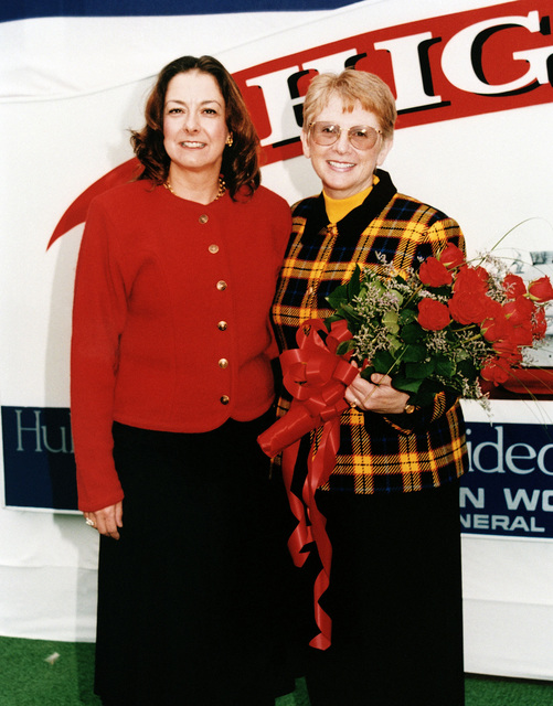 Lieutenant Colonel Robin Higgins, USMC, (Ret.) ships sponsor (right), and Lieutenant Colonel Joanne Schilling, USMC (Ret.), matron of honor pose for a photograph in front of the reviewing stand at the official christening ceremony of the guided missile destroyer USS HIGGINS (DDG 76), (vessel not shown)