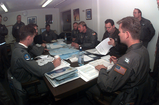 7th and 8th Airlift Squadron's aircrew members sit at a table during a preflight briefing prior to flying a resupply mission to McMurdo Base, Antarctica. The 62nd Airlift Wing crews and their C-141B Starlifters from McChord Air Force Base, Washington are deployed to support the joint, U.S. Armed Forces and New Zealand Defense Force, military operation which provides logistic support to the U.S. National Science Foundation's Program on Antarctica